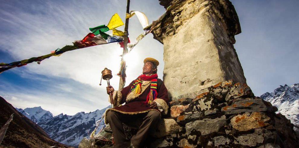Man with prayer wheel in Helambu